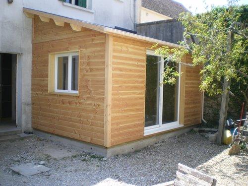 Каркасная пристройка к деревянному дому