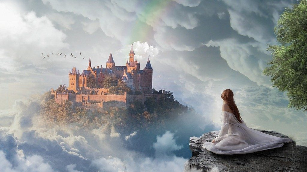 красивый замок в облаках, девушка в белом платье сидит на скале и смотрит на замок